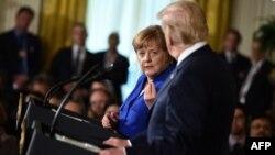 La chancelière allemande Angela Merkel lors d'une conférence de presse conjointe avec le président américain Donald Trump à la Maison Blanche, à Washington, le 27 avril 2018.