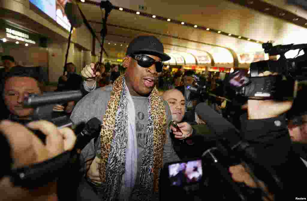 Dennis Rodman speaks to the media after returning from his trip to North Korea at Beijing airport, China, Dec. 23, 2013.
