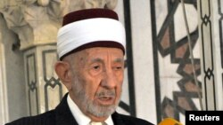 FILE-Syrian cleric Mohammed al-Buti speaking at a mosque.