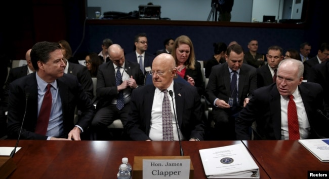 Then-FBI Director James Comey (L), then-U.S. Director of National Intelligence James Clapper (C) and then-CIA Director John Brennan (R) take their seats to testify at a hearing on Capitol Hill in Washington, Feb. 25, 2016. President Donald Trump has referred to the three as political hacks complicit in what he calls a Democratic set-up of the Russia meddling story.