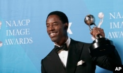 "FILE - Isaiah Washington holds the award for outstanding actor in a drama series for his work on ""Grey's Anatomy"" at the 38th NAACP Image Awards in Los Angeles, March 2, 2007."