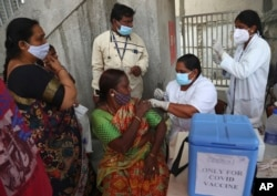 A health worker administers the Covishield vaccine for COVID-19 during a special vaccination drive in Hyderabad, India, Sept. 17, 2021.