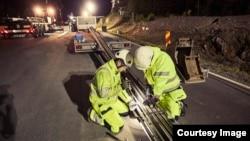 Engineers work to install an electrified track along a highway near Arlanda airport outside Stockholm, Sweden. (eRoadArlanda)