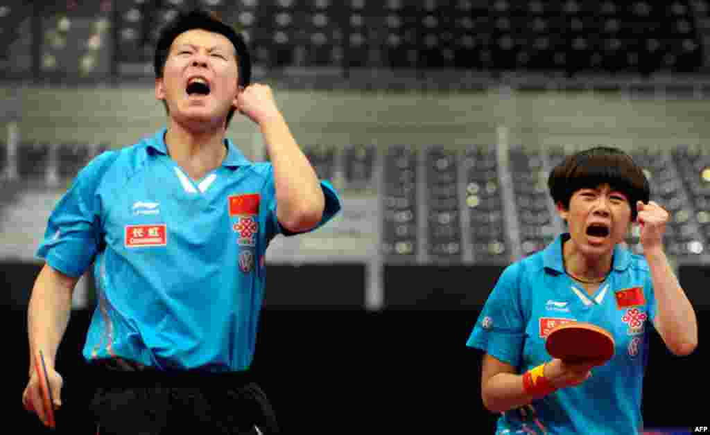May 13: Zhang Chao (L) and Cao Zhen of China during their mixed doubles final at the World Table Tennis Championships in Rotterdam. (REUTERS/Robin van Lonkhuijsen)