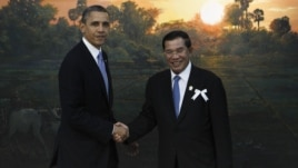US President Barack Obama, left, poses with Cambodia's PM Hun Sen for photographers before the ASEAN-U.S. leaders meeting in Phnom Penh, Cambodia, November 19, 2012.