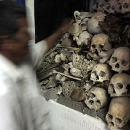 A Cambodian man stands in front of human bones and skulls of victims of the Khmer Rouge at a small shrine in Phnom Sampove, Battambang province, 314 kilometers (195 miles) northwest of Phnom Penh (file photo)
