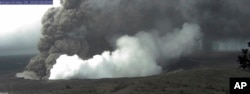 This view from a U.S. Geological Survey webcam shows small explosive episodes at Halema'uma'u Crater at Kīlauea Volcano's summit, which scientists say are caused by magma withdrawing from a shallow reservoir beneath the east margin of the crater, in Hawaii Volcanoes National Park on the island of Hawaii, May 25, 2018.