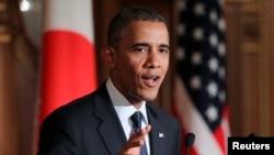 지난 2014년 일본 도쿄를 방문한 바락 오바마 미국 대통령이 아베 신조 일본총리와 정상회담 후 공동기자회견에서 발언하고 있다. (자료사진)