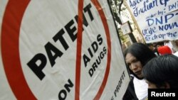 FILE - A protest against drug manufacturer Novartis.