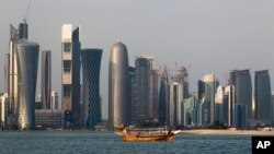 FILE - A traditional dhow floats in the Corniche Bay of Doha, Qatar, Jan. 6, 2011. Saudi media reported April 9, 2018, a proposal to dig a maritime canal along the kingdom's closed border with Qatar, turning the peninsula-nation into an island and further isolating it.