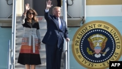 U.S. President Donald Trump and first lady Melania wave as they arrive at Yokota Air Base at Fussa in Tokyo, Nov. 5, 2017.