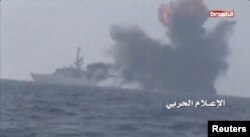 FILE - An explosion is seen onboard what is believed to be a Saudi warship, off the western coast of Yemen in this still frame taken from video posted by Houthi-run al-Masirah television on their social media website, and obtained by Reuters, Jan. 31, 2017.