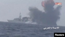 An explosion is seen onboard what is believed to be a Saudi warship, off the western coast of Yemen in this still frame taken from video posted by Houthi-run al-Masirah television on their social media website, and obtained by Reuters, Jan. 31, 2017.