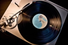 An old vinyl record album on a turntable.