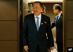 North Korean Foreign Minister Ri Yong Ho emerges from his bilateral meeting with his Chinese counterpart Wang Yi, right, in the sidelines of the 50th ASEAN Foreign Ministers' Meeting and its Dialogue Partners, Aug. 6, 2017 in Manila, Philippines.