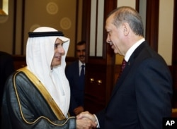FILE - Turkey's President Recep Tayyip Erdogan, right, greets Saudi Arabia's Foreign Minister Adel al-Jubeir before a meeting in Ankara, Oct. 15, 2015.
