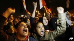 Protesters chant slogans during a demonstration in front of the presidential palace in Cairo, Egypt, Sunday, Dec. 9, 2012.