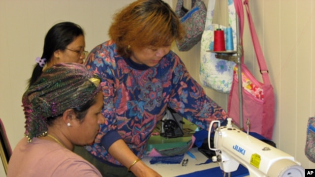 Phyu Phyu Aye teaches sewing and helps her students adapt to a new culture at the Refugee Resource Center.