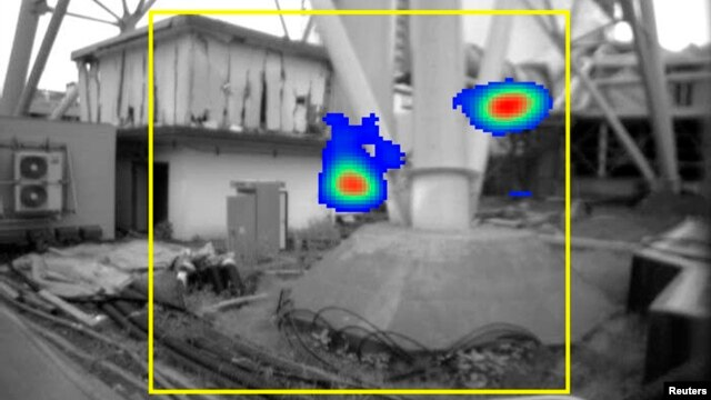 Tokyo Electric Power Company's image taken by a gamma ray camera showing the bottom of a ventilation stack standing between Fukushima Daiichi nuclear power plant's No.1 and No.2 reactors, where radiation exceeding 10 sieverts per hour was found as shown in red, in Fukushima prefecture, northern Japan, July 31, 2011.