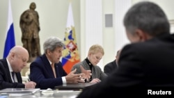 U.S. Secretary of State John Kerry (2nd L) speaks during a meeting with Russian President Vladimir Putin (not pictured) at the Kremlin in Moscow, March 24, 2016.