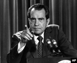 FILE - In this March 15, 1973, file photo President Nixon tells a White House news conference that he will not allow his legal counsel, John Dean, to testify on Capitol Hill in the Watergate investigation.