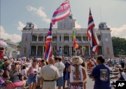 Hawaiians who marched from the Royal Mausoleum in Nuuanu arrived at Iolani Palace Wednesday Aug. 12, 1998 to begin a somber commemoration of the 100th anniversary of the annexation of Hawaii by the United States in Honolulu, Hawaii.
