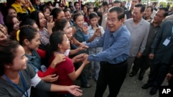 Cambodia's Prime Minister Hun Sen greets garment workers during a visit to the Phnom Penh Special Economic Zone on the outskirts of Phnom Penh, Cambodia, Aug. 23, 2017. The U.S. State Department expressed concern Wednesday about what it said it was the d