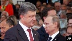 Порошенко і Путін в Нормандії 6 червня 2014 р.