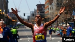Meb Keflezighi of the U.S. reacts as he wins the men's division at the 118th running of the Boston Marathon in Boston, Massachusetts April 21, 2014. REUTERS/Brian Snyder (UNITED STATES - Tags: SPORT ATHLETICS) - RTR3M3XB