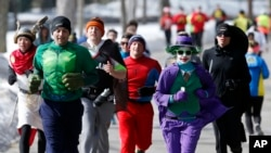 Runners in costume train for the Boston Marathon in Newton, Mass., March 1, 2014.