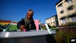 A Nepalese voter casts his vote at a polling station in Bhaktapur, Nepal, Tuesday, Nov. 19, 2013.