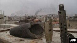 Khói bốc lên từ khu ngoại ô của Erbeen ở Damascus, ngày 30/1/2012