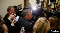 House Freedom Caucus Chairman Rep. Mark Meadows (R-NC) is surrounded by reporters and television cameras as he arrives at a caucus meeting after a trip to the White House to meet with President Donald Trump about the AHCA health care bill in Washington, March 23, 2017.