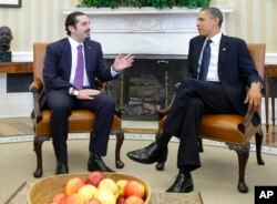 FILE - In this Jan. 12, 2011 photo, President Barack Obama meets with Lebanese Prime Minister Saad Hariri, in the Oval Office of the White House in Washington. Hariri who resigned from Saudi Arabia nearly two weeks ago has been caught in the crossfire between the region's two feuding powers - Sunni Saudi Arabia and Shiite Iran.