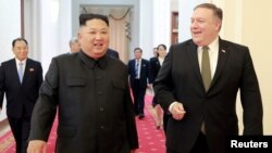 FILE - North Korean leader Kim Jong Un meets with U.S. Secretary of State Mike Pompeo in Pyongyang in this photo released by North Korea's Korean Central News Agency (KCNA), Oct. 7, 2018.