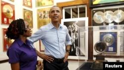 President Barack Obama gets tour of the Bob Marley Museum from staff member Natasha Clark, Kingston, Jamaica, April 8, 2015.