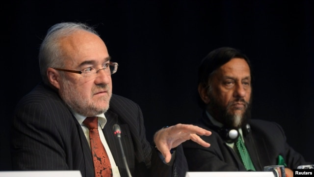 FILE - Michel Jarraud, WMO secretary-general, speaks next to IPCC Chairman Rajendra Pachauri during a news conference in Stockholm, Sept. 27, 2013.