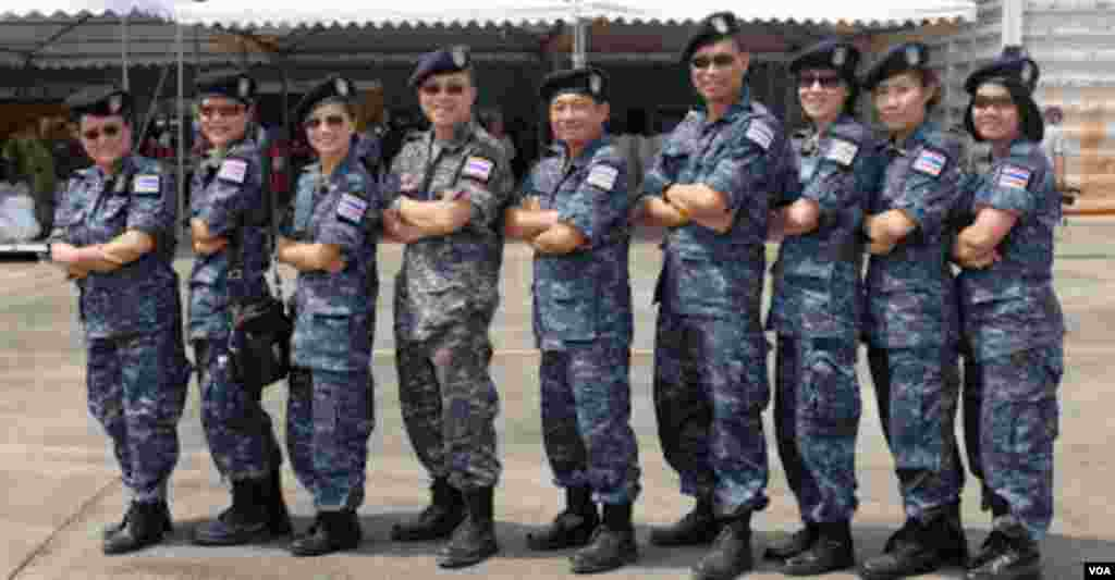 A group of Thai military personnel pose for a photograph after conducting a civilian evacuation drill. (Steve Herman/VOA News)