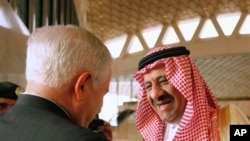 U.S. Defense Secretary Robert Gates, left, is greeted by Saudi Assistant Minister of Defense and Aviation Prince Khalid bin Sultan, on Gates' arrival in Riyadh, Saudi Arabia, April 6, 2011