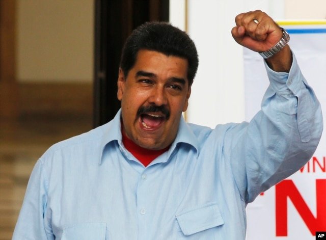 FILE - Venezuela's President Nicolas Maduro speaks during a demonstration, at Miraflores Presidential Palace in Caracas, April 7, 2016.