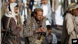 FILE - Houthi Shiite militants attend rally to show support for their leader Abdel-Malik al-Houthi, Sanaa, Yemen, Feb. 20, 2015.