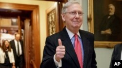 Senate Majority Leader Mitch McConnell of Kentucky signals a thumbs-up as he leaves the Senate chamber on Capitol Hill in Washington, April 6, 2017, after he led the GOP majority to change Senate rules and lower the vote threshold for Supreme Court nominees from 60 votes to a simple majority in order to advance Neil Gorsuch to a confirmation vote.