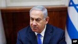 FILE - Israeli Prime Minister Benjamin Netanyahu chairs the weekly cabinet meeting in Jerusalem, March 3, 2019.