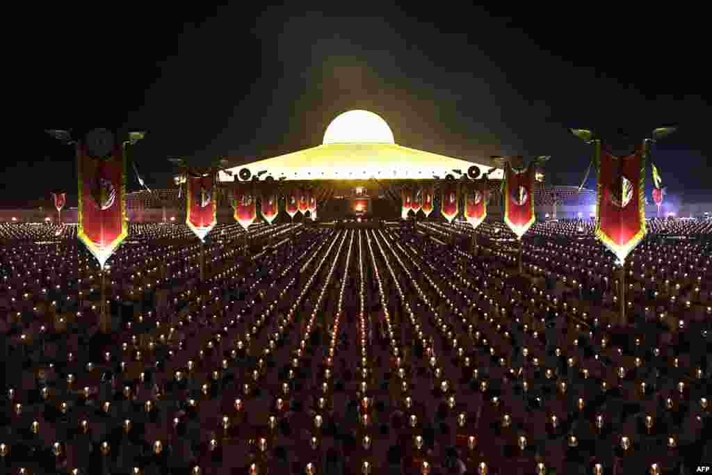 Devotees pray to mark Makha Bucha Day at the Wat Phra Dhammakaya temple, near Bangkok, Thailand, Feb. 19, 2019.