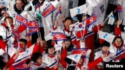 Athletes from North Korea and South Korea during the closing ceremonies of the 2018 Winter Olympics in Pyeongchang, South Korea, February 25, 2018