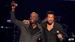 "Darius Rucker, left, and Lionel Richie perform ""Stuck on You"" at a concert last week in Las Vegas, Nevada"