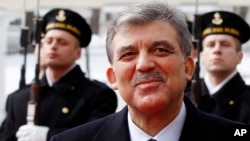 FILE - Turkey's Former President Abdullah Gul. Gul, a longtime ally of President Tayyip Erdogan also expressed concern about the new emergency decree, in a rare show of opposition.