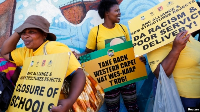 Supporters of President Jacob Zuma's ruling African National Congress await the start of a march to the headquarters of the opposition Democratic Alliance in Cape Town, South Africa, Feb. 5, 2014.