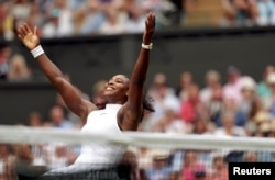 Serena Williams of the United States celebrates winning her womens singles final match against Germany's Angelique Kerber at Wimbledon, July 9, 2016.