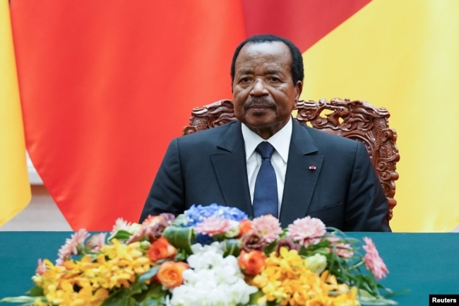 FILE - President of Cameroon Paul Biya attends a signing ceremony with Chinese President Xi Jinping (not pictured) at The Great Hall Of The People in Beijing, China, March 22, 2018.